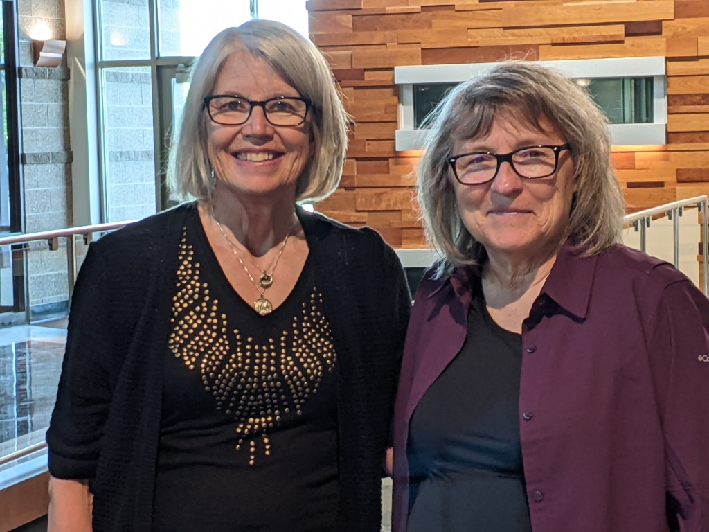 Roxane Pfister 2020-2021 President handing off to Sherry Meidell incoming 2021-2022 President at our June 1, 2021 closing social at UCCC.